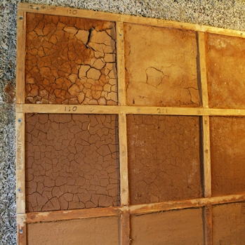 Site-made earthplaster mix tests on hempcrete wall
