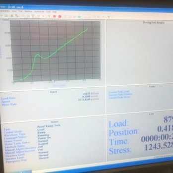 Compressive strength testing software in the Concrete Teaching Lab at UNC Charlotte