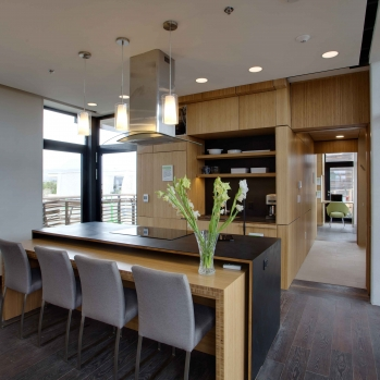 The kitchen counter extends to become a table to serve eight.