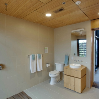 The bathroom serves as a corridor between the public and private spaces...