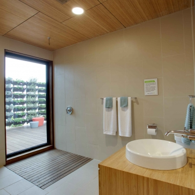 The shower opens out onto the private outdoor bedroom.