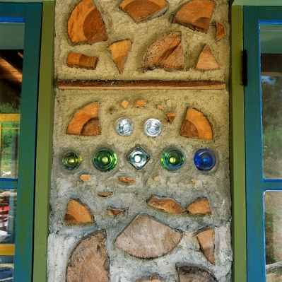...and to protect the cordwood which is set with an exposed endgrain.