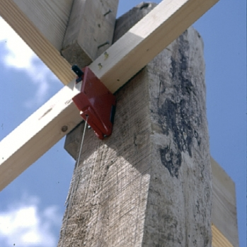 Site-harvested locust post with commercial dimensional  lumber truss